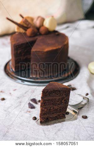 Slice of a homemade ultimate chocolate cake on a vintage cake server