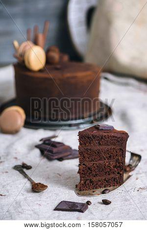 Handmade chocolate cake, coffee beans and cocoa