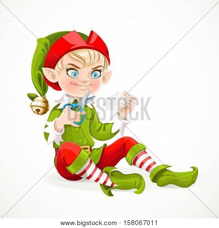 Cute boy elf sitting on the floor and cuts out a snowflake from a paper isolated on white background