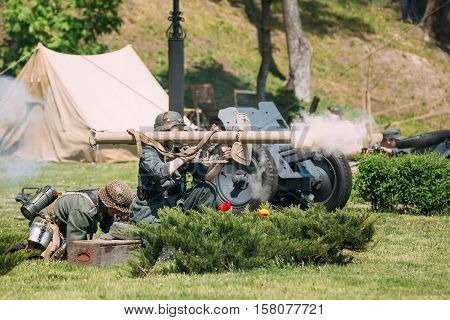 Gomel, Belarus - May 9, 2016: Two Wehrmacht Reenactors Recreate Shooting During The Battle Of WW2. Scene Of Historical Reenactment  On Celebrating Victory Day 9 May.