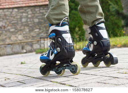 Roller skate legs close up in skatepark. Low section. Roller skates is extreme sport.