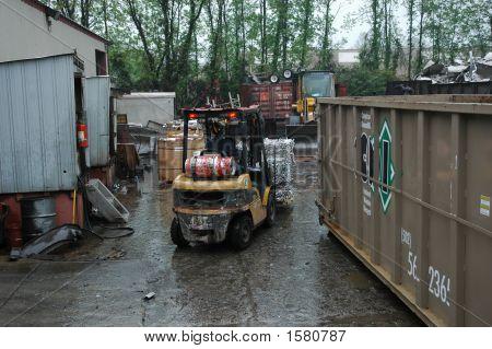 Forklift Worker At Salvage Yard
