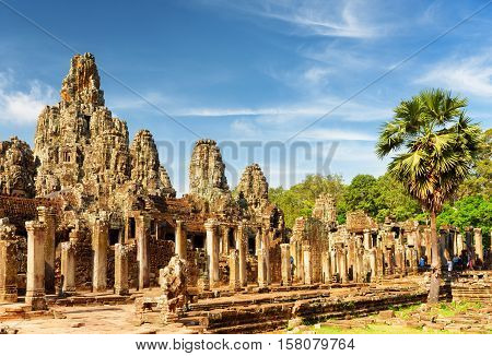 Main View Of Ancient Bayon Temple In Angkor Thom In Evening Sun