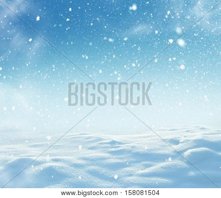 Christmas winter background with snow and blurred bokeh.Merry Christmas and happy New Year greeting card with copy-space.Winter christmas landscape with falling snow