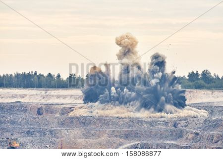Explosion blast in open cast mining quarry mine