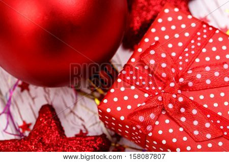 Red Spotted Present Box Lies Between Christmas Tree Toys