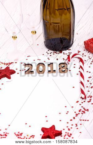Wooden Number 2018 Lies On White Wooden Table Between Candy Canes And Bottles