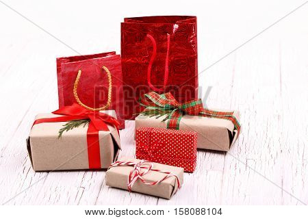 Red Packages And Present Boxes Stand On White Floor