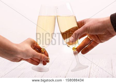 Man And Woman Clang Glasses With Champagne