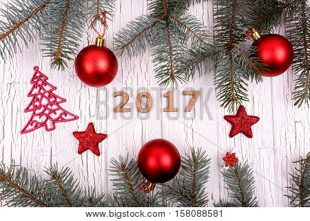 Wooden Number 2017 Lies In A Circle Of Fir Branches And Christmas Tree Toys