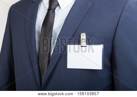 Businessman Wearing A Blank Id Tag Or Name Card During An Exhibition Or A Conference