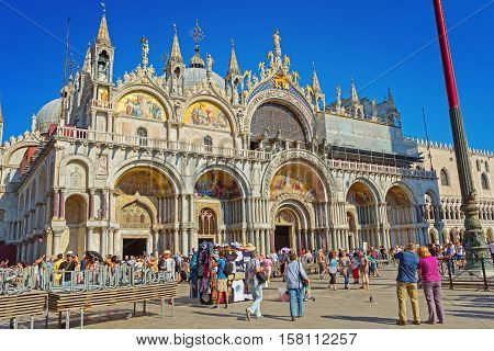 Venice Italy - September 8 2016: Patriarchal Cathedral Basilica of Saint Mark (828 1094). Piazza San Marco full of people Venice Italy.