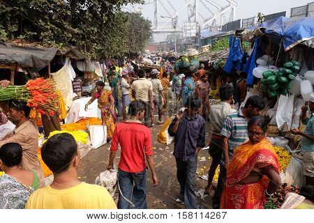 KOLKATA, INDIA - FEBRUARY 10: People buying and selling flowers and garlands at the flower market in Kolkata on February 10, 2016.