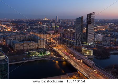 Residential building under construction, Third Transport Ring, river at night in Moscow, Russia