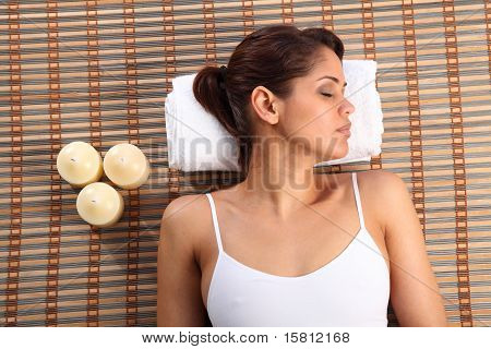 Woman in health spa head on towel