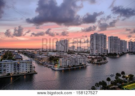 Colorful sunset on high rise condos in Miami Beach Florida