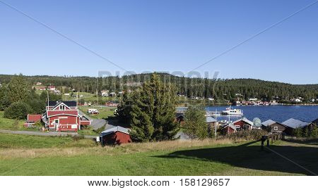 HIGH COAST HERITAGE, SWEDEN ON SEPTEMBER 05. View of the small village by the sea on September 05, 2016 in Barsta, Sweden. Buildings and seascape. Sunshine. Editorial use.