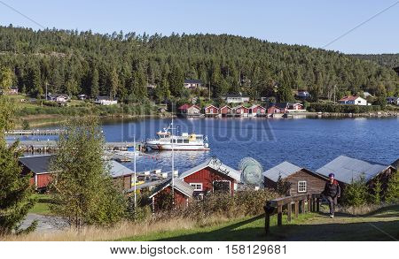 HIGH COAST HERITAGE, SWEDEN ON SEPTEMBER 05. View of the small village by the sea on September 05, 2016 in Barsta, Sweden. Unidentified hiker. Sunshine. Editorial use.