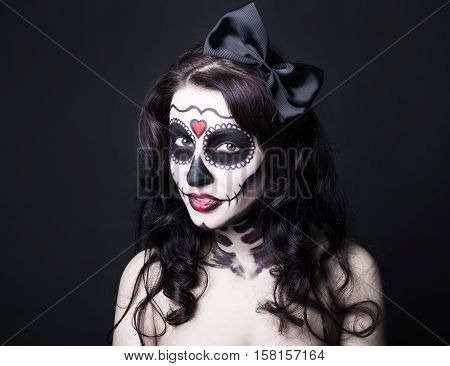 Close Up Portrait Of Beautiful Woman With Creative Halloween Skull Make Up Over Black