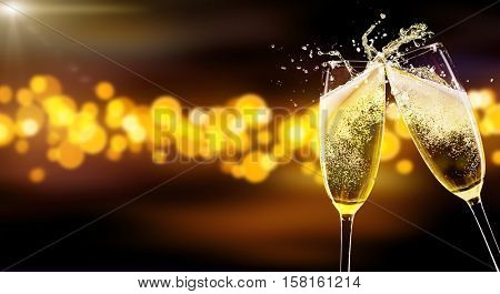 Two glasses of champagne over blur spots lights background. Celebration concept, free space for text