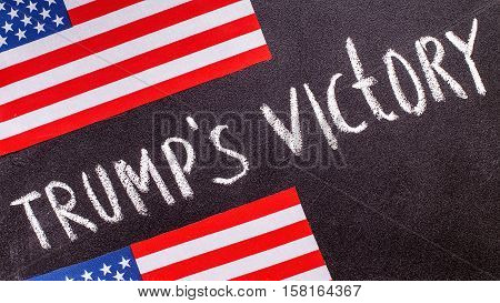 Trump's victory on the chalk board and US flag. Election concept