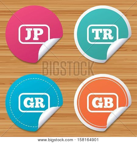 Round stickers or website banners. Language icons. JP, TR, GR and GB translation symbols. Japan, Turkey, Greece and England languages. Circle badges with bended corner. Vector