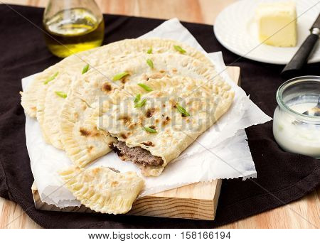 Tatar meat pie yantyk with ground beef and cheese