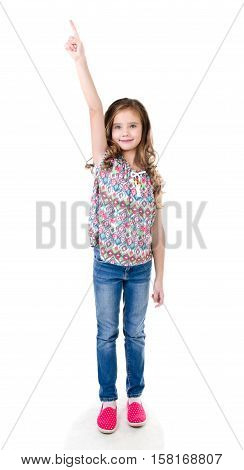 Cute little girl is pointing up isolated on a white