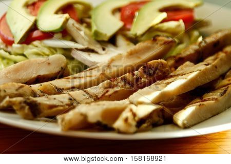 chicken fajitas with vegetables on a white plate