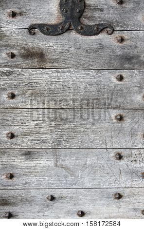 Texture of ancient wood of grey color with metal rivets