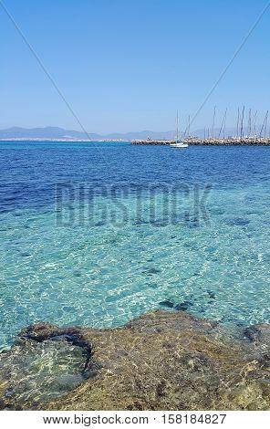 Beautiful sea views with yacht and Palma de Mallorca on the horizon. L'Arenal Majorca Balearic Islands Spain.