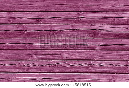 Weathered Pink Color Log House Wall.