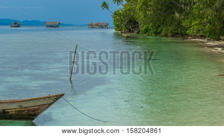 Fisherman boat near Diving Station and Guesthouses on Kri Island, Raja Ampat, Indonesia, West Papua.