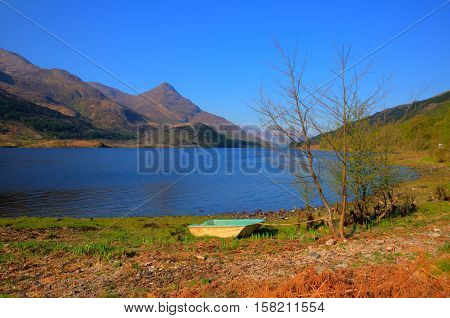 Rowing boat shore of Loch Leven Scottish lake west coast of Scotland in Scottish Highlands west of Kinlochleven and just off B863 south of Ben Nevis