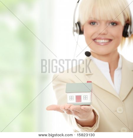 Young businesswoman in headset holding two hose models