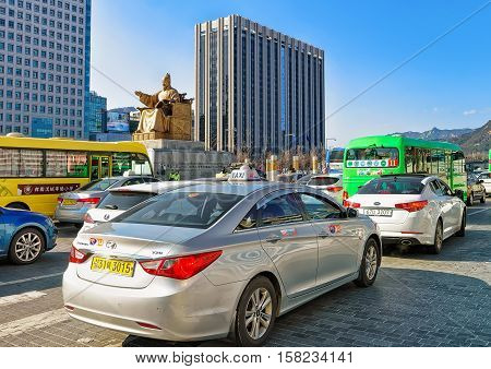 Car Traffic At Statue Of King Sejong On Gwanghwamun Square