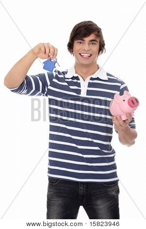 Young man with key and piggy bank. Isolated on white background.