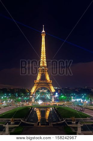 Illuminated Eiffel Tower At Night In Paris France
