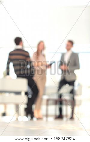 Blurred business people standing in building hall , can be used