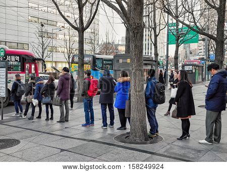 People Staying In Queue For Bus In Jung District Seoul