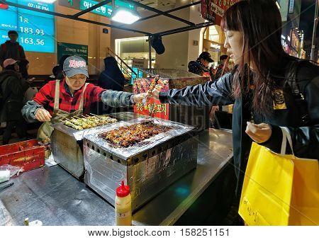 Purchase Of Kebab Skewers In Myeongdong Open Street Market Seoul