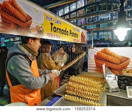 Seller Of Potato Chips In Myeongdong Open Street Market Seoul