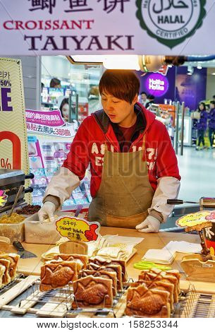 Seller Of Buns At Myeongdong Open Street Market In Seoul