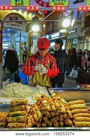 Seller Of Food On Skewers At Myeongdong Open Street Market