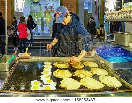 Seller Of Pancakes At Myeongdong Open Street Market In Seoul