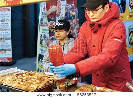 Seller Of Street Food In Myeongdong Open Street Market In Seoul