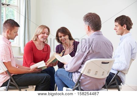 Group Of People Attending Book Reading Club
