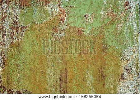 Old Rust Eroded Green Metal Sheet Decay Crumpled Iron Background. Weathered Iron Rusty Messy Wreck Isolated Texture. Corroded Iron Metal Structure. Abstract Aged Yellow Shabby Steel Sheet Surface.