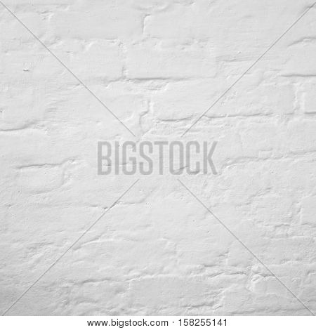 Abstract Rectangular White Texture. White Washed Old Brick Wall With Stained And Shabby Uneven Plaster. Painted White Grey Brickwall Background. Home House Room Interior Design Element Shabby Background Texture.