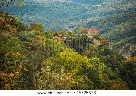 Autumn Landscape With Multicolored Trees And Small Church. Gorge Of Louise